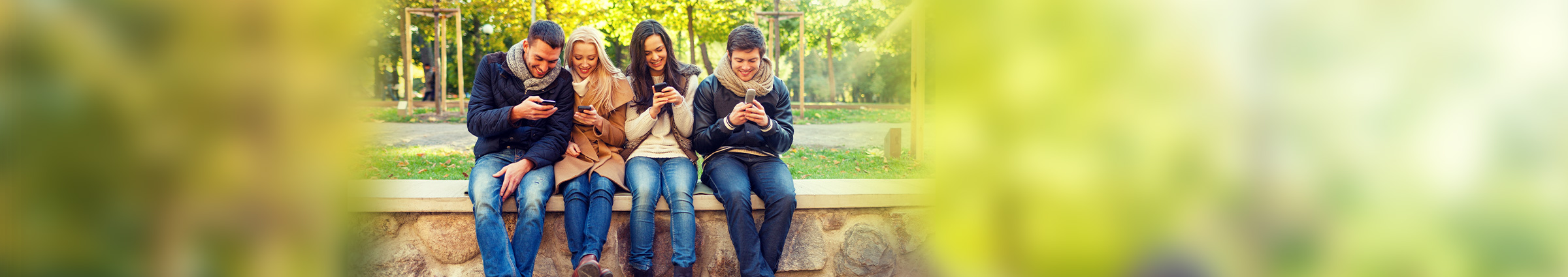 Group of young people on cellphones outside